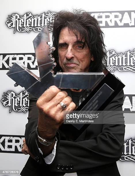 Alice Cooper is seen with his Kerrang award at the Relentless Energy Drink Kerrang Awards at the Troxy on June 11 2015 in London England