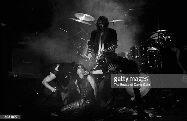 Alice Cooper Neal Smith Glen Buxton and Dennis Dunaway of the rock group Alice Cooper perform in November 1972 at Hofstra University in New York City...