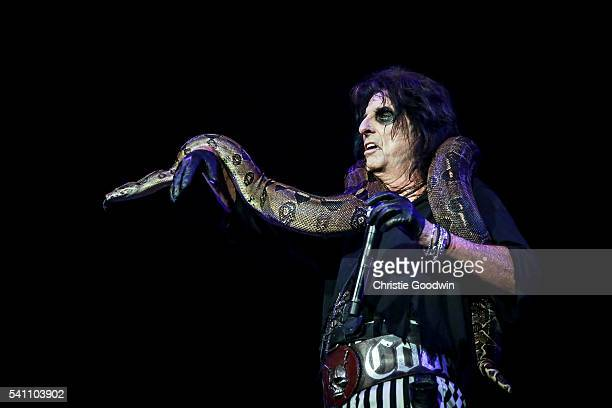 Alice Cooper performs on stage with a snake at The O2 Arena on June 18, 2016 in London, England.