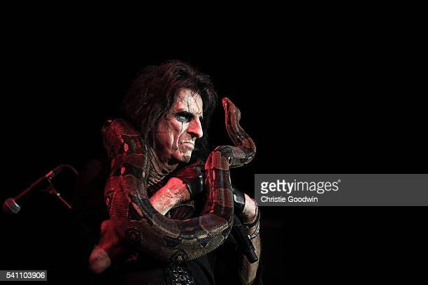 Alice Cooper performs on stage with a snake at The O2 Arena on June 18 2016 in London England
