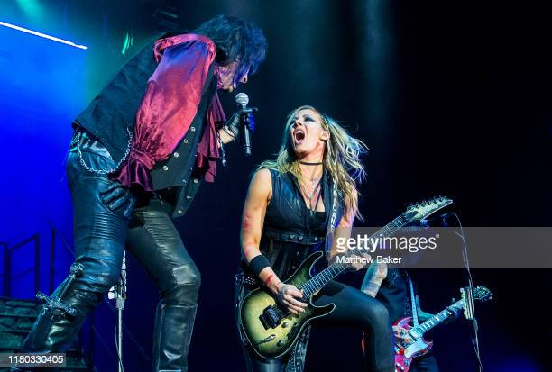 Alice Cooper performs with Nita Strauss on stage at The O2 Arena on October 10, 2019 in London, England.