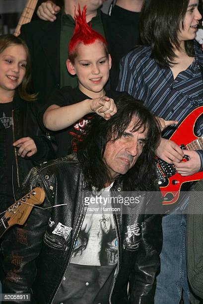 Alice Cooper performs with the kids from 'New School' at Plan B during the 2005 Sundance Film Festival on January 24 2005 in Park City Utah