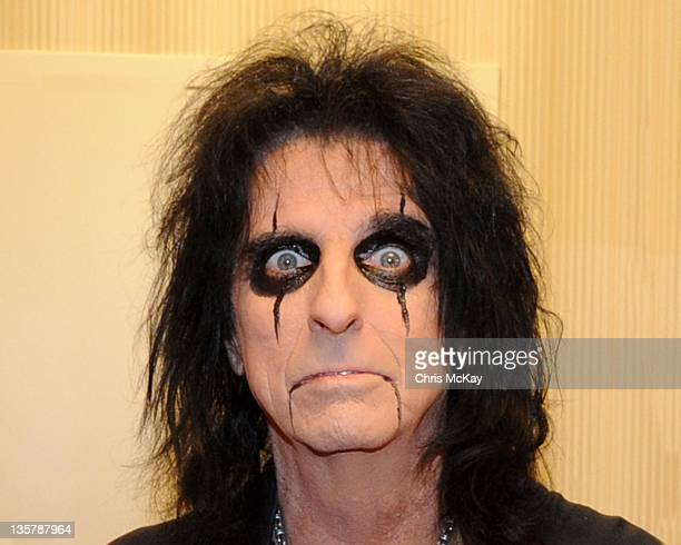 Alice Cooper poses backstage at the Cobb Energy Center on December 13 2011 in Atlanta Georgia