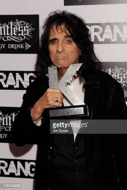 Alice Cooper poses with the Kerrang Icon Award at The Relentless Energy Drink Kerrang Awards at The Brewery on June 9 2011 in London England