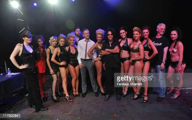 Alice Cooper poses with the winners of 'Fire and Freaks at Hyde Park on June 27 2011 in London England