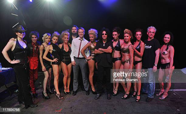 Alice Cooper poses with the winners of 'Fire and Freaks' at Hyde Park on June 27 2011 in London England