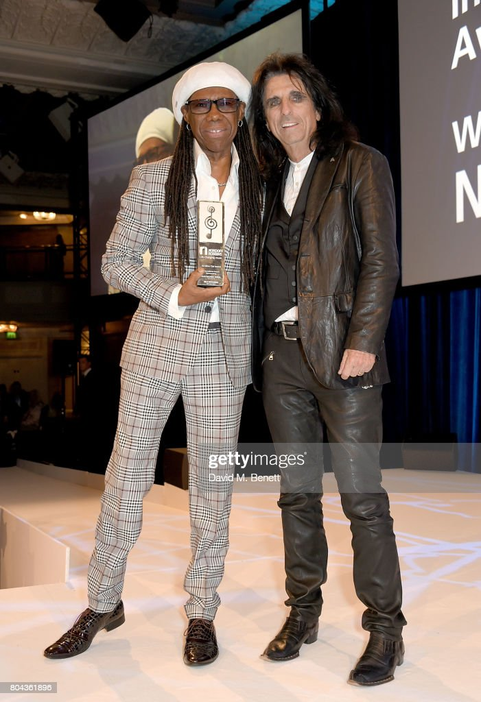 Alice Cooper (R) presents Nile Rodgers with the Raymond Weil International Award at the Nordoff Robbins O2 Silver Clef Awards at The Grosvenor House Hotel on June 30, 2017 in London, England.