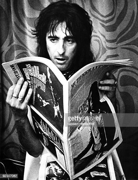 Alice Cooper reading a music paper in his hotel room in Amsterdam Netherlands in 1974