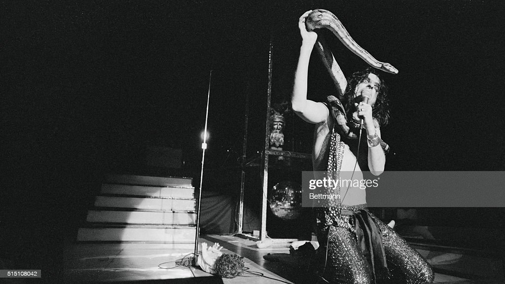 Alice Cooper Performing with a Boa Constrictor : News Photo