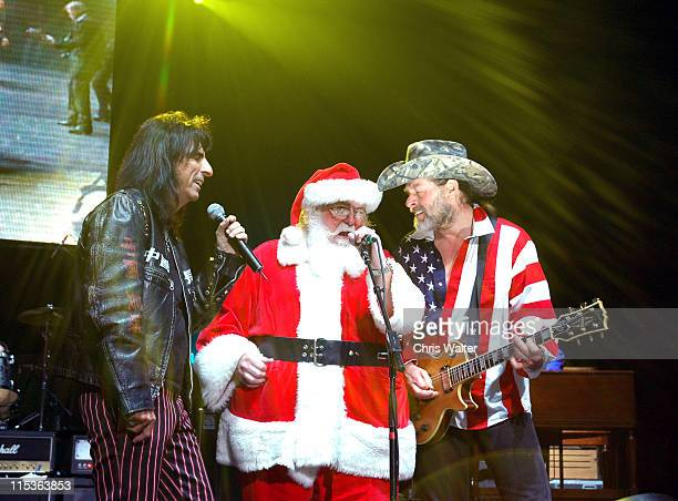Alice Cooper Santa Claus and Ted Nugent during Alice Cooper's 'Christmas Pudding' Concert to Benefit Solid Rock Foundation Show at Dodge Theatre in...