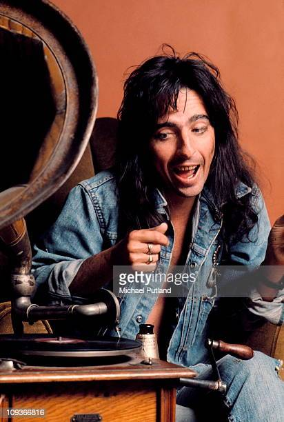 Alice Cooper studio portrait London listening to old fashioned gramphone with horn