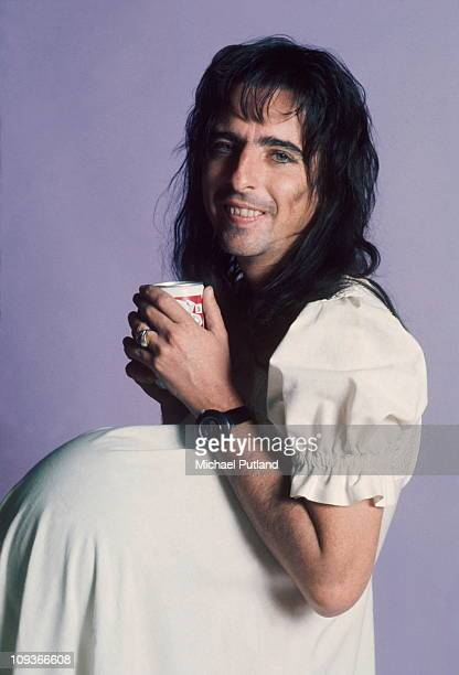 Alice Cooper studio portrait London wearing dress and false pregnancy bulge