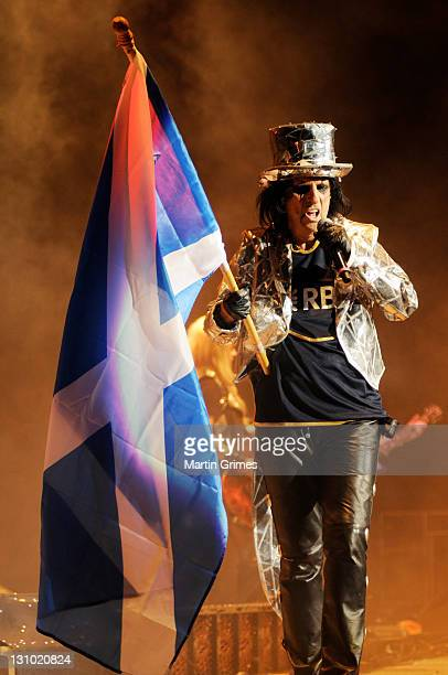 Alice Cooper waves the Scottish flag while performing during his 'No More Mr Nice Guy' at the SECC on October 31 2011 in Glasgow Scotland