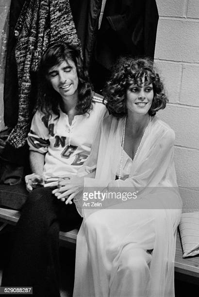 Alice Cooper with a young lady being interviewed circa 1970 New York