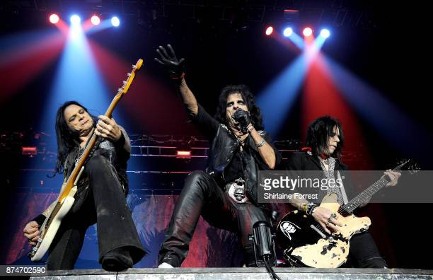 Alice Cooper with bassist Chuck Garric and guitarist Tommy Henriksen perform live on stage at Manchester Arena on November 15 2017 in Manchester...