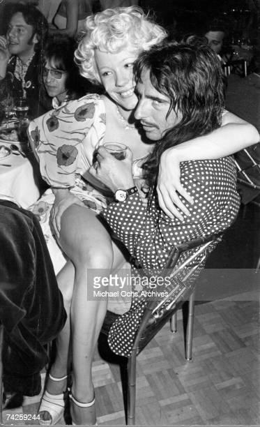 Alice Cooper with Pamela Des Barres and Rodney Bingenheimer in the background