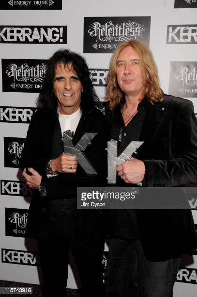 Alice Cooper with the Kerrang Icon Award and Joe Elliott of Def Leppard with the Kerrang Inspiration Award pose at The Relentless Energy Drink...