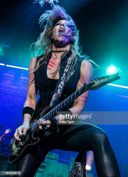 Alice Cooper's guitarist Nita Strauss performs on stage at Resorts World Arena on October 11, 2019 in Birmingham, England.
