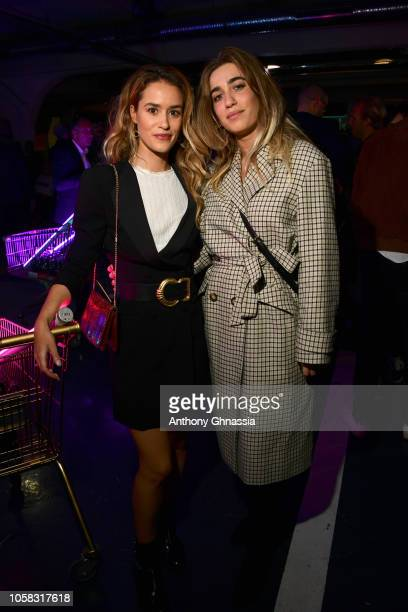 Alice David and Joanne Palmaro attend MOSCHINO [tv] HM Launch Party at Le Dernier Etage on November 6 2018 in Paris France