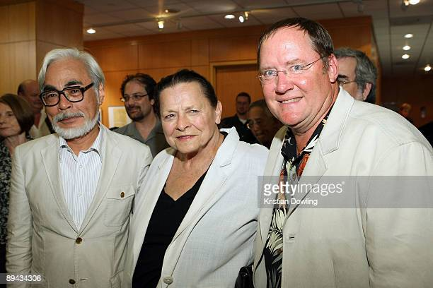 Alice Davis daughter of Marc Davis poses with John Lasseter chief creative officer of Pixar and Disney Animation Studios and principal creative...