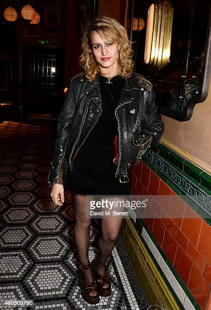 Alice Dellal attends the LOVE x Balmain Xmas Party at The Ivy Market Grill on December 15 2014 in London England