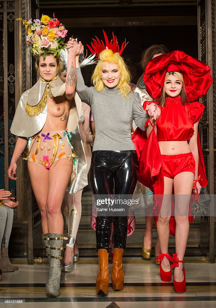 Alice Dellal, Pam Hogg and a model walk the runway at the Pam Hogg show during London Fashion Week Fall/Winter 2015/16 at Fashion Scout Venue on February 22, 2015 in London, England.