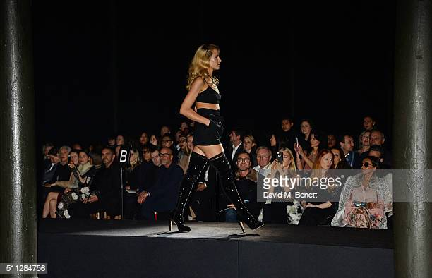 Alice Dellal walks the runway at the Charlotte Olympia Fall 16 catwalk show at The Roundhouse on February 19 2016 in London England