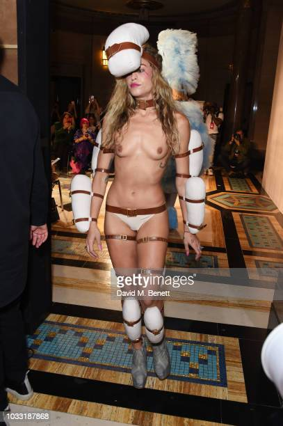 Alice Dellal walks the runway at the Pam Hogg show during London Fashion Week September 2018 at The Freemason's Hall on September 14 2018 in London...