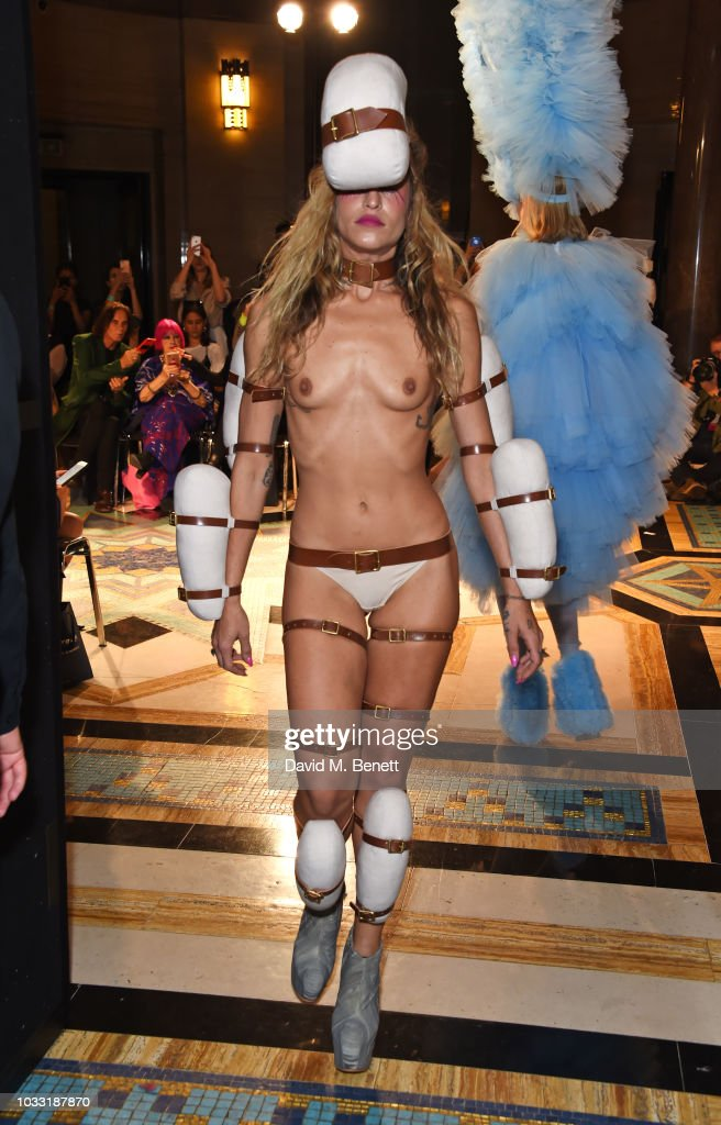 Alice Dellal walks the runway at the Pam Hogg show during London Fashion Week September 2018 at The Freemason's Hall on September 14, 2018 in London, England.