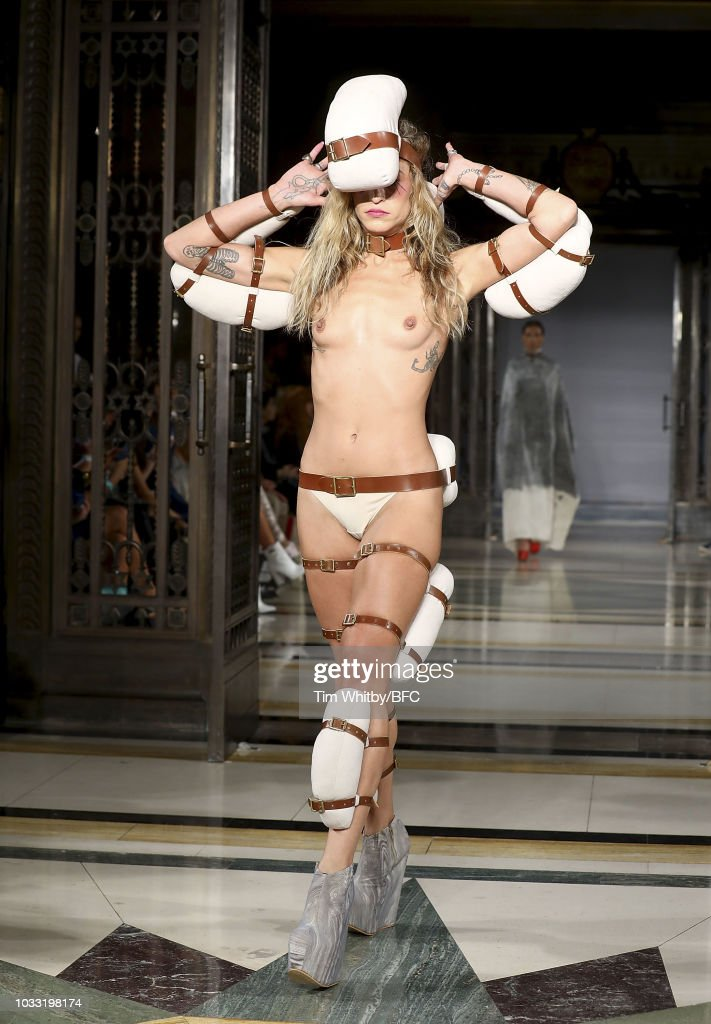 Alice Dellal walks the runway at the Pam Hogg Show during London Fashion Week September 2018 at Freemasons Hall on September 14, 2018 in London, England.