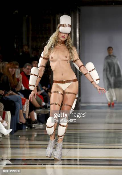 Alice Dellal walks the runway at the Pam Hogg Show during London Fashion Week September 2018 at Freemasons Hall on September 14 2018 in London England