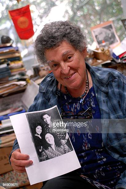 Alice Dewey professor of Anthropology at the University of Hawaii holds a photo of Ann Dunham and Dunham's children presidential candidate Barack...