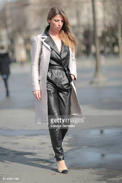 Alice Didier de Bourgues is wearing a Chanel coat a Chanel bag Chanel shoes and Maison Ullens leather top and pants after the Chanel show during...