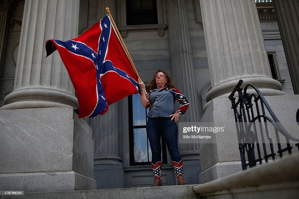 Alice Dixie Horky, of Greenville, South Carolina joins a group of demonstrators on the steps of the South Carolina State House calling for the Confederate flag to remain on the State House grounds June 27, 2015 in Columbia, South Carolina. Earlier in the week South Carolina Gov. Nikki Haley expressed support for removing the Confederate flag from the State House grounds in the wake of the nine murders at Mother Emanuel A.M.E. Church in Charleston, South Carolina.