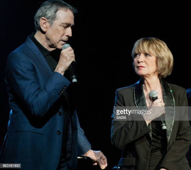 Alice Dona and Alain Chamfort perform on stage during a concert at L'Alhambra Paris on April 7 2013 in Paris France