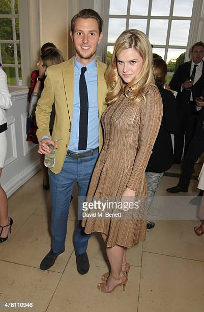Alice Eve and Alex CowperSmith attend The Ralph Lauren Vogue Wimbledon Summer Cocktail Party hosted by Alexandra Shulman and Boris Becker at The...