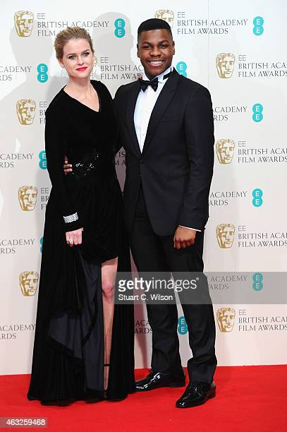 Alice Eve and John Boyega pose in the winners room at the EE British Academy Film Awards at The Royal Opera House on February 8 2015 in London England