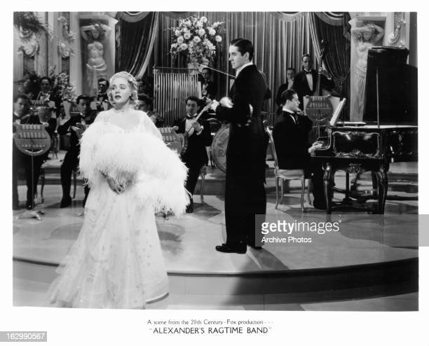 Alice Faye sings as Tyrone Power conducts in a scene from the film 'Alexander's Ragtime Band' 1938