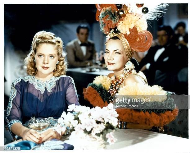 Alice Faye sitting at table with Carmen Miranda in a scene from the film 'WeekEnd In Havana' 1941