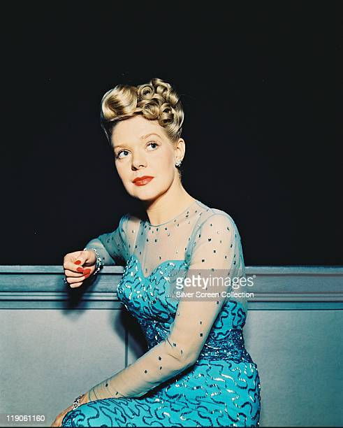 Alice Faye US actress wearing a blue dress with chiffon sleeves circa 1940