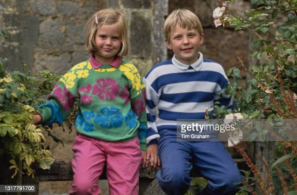 Alice Ferguson and her brother, Andrew Ferguson, in the garden of Dummer Down Farm in Dummer, Hampshire, 6th July 1986. Alice and Andrew are Major...