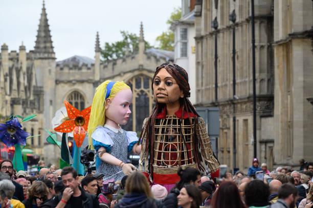 GBR: Little Amal Meets Alice In Wonderland In Oxford
