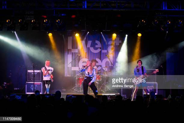 Alice Gough Rakel Leifsdottir and Isabella Podpadec of Dream Wife perform on stage at Beckett University Union during Live At Leeds festival on May...
