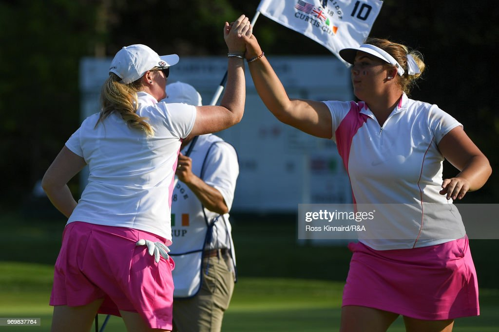 Alice Hewson and India Clyburn celebrate on the tenth green during foursomes matches on day one of the 2018 Curtis Cup at Quaker Ridge Golf Club on June 8, 2018 in Scarsdale, New York.