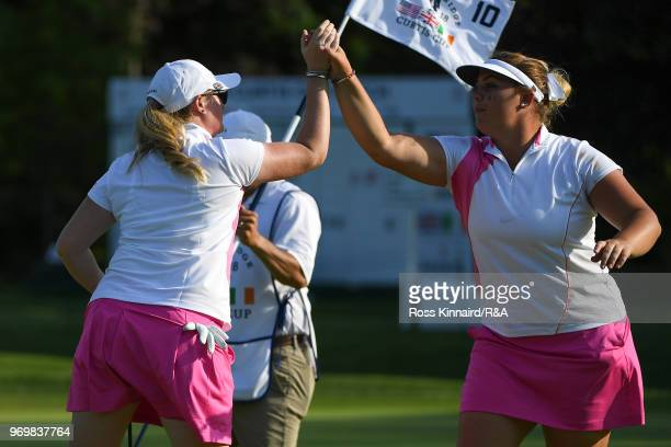 Alice Hewson and India Clyburn celebrate on the tenth green during foursomes matches on day one of the 2018 Curtis Cup at Quaker Ridge Golf Club on...