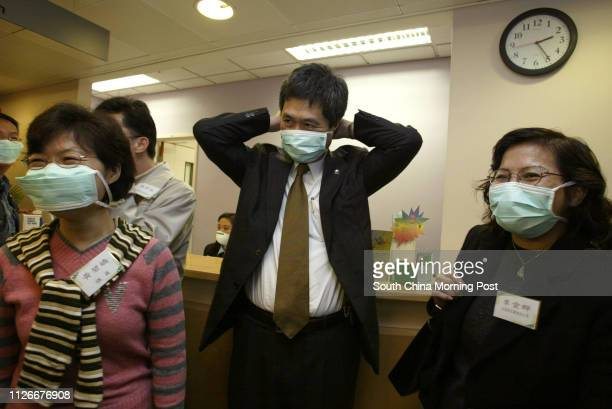 Alice Ho Miu Ling Nethersole Hospital chief executive Raymond Chen talks to staff during a visit to the facility's hardpressed emergency unit The...