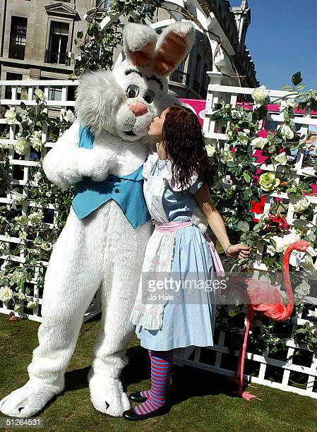 Alice in Wonderland is seen and the March Hare at the Mad Hatters Tea Party at the Regent Street Festival in central London on September 5 2004 in...