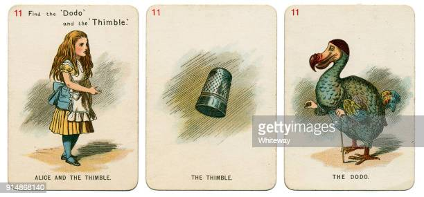 alice in wonderland playing cards 1898 set 11 - dodo bird stock photos and pictures