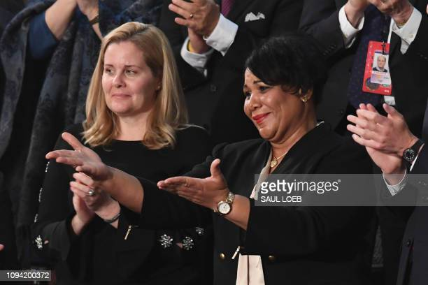 Alice Johnson one of the US President's special guests reacts as the president acknowledges her during his State of the Union address at the US...