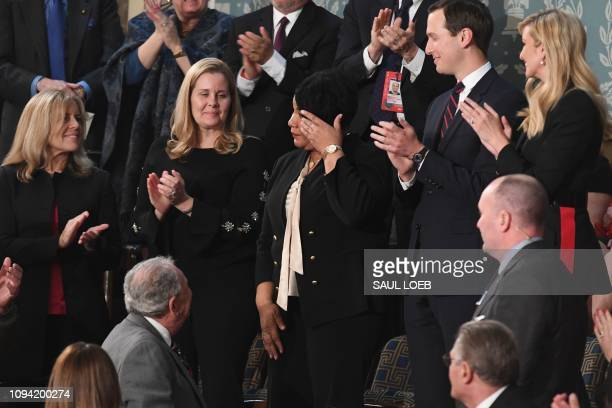 Alice Johnson one of the US President's special guests wipes away a tear as the president acknowledges her during his State of the Union address at...